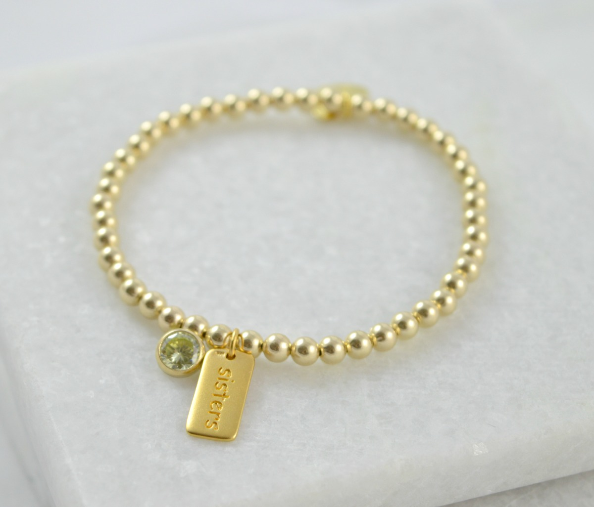 gold sisters bracelet with peridot birthstone