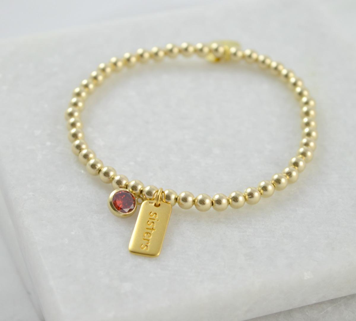 gold sisters bracelet with garnet