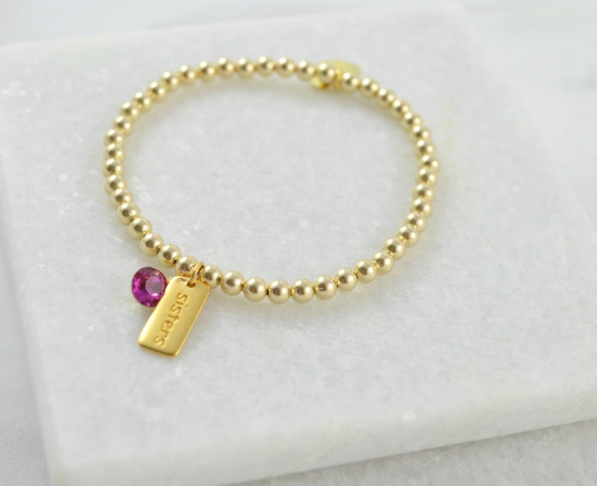gold sisters bracelet with fuschia swarovski