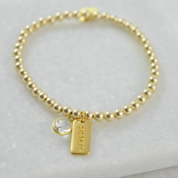 Gold sisters bracelet with crystal birthstone