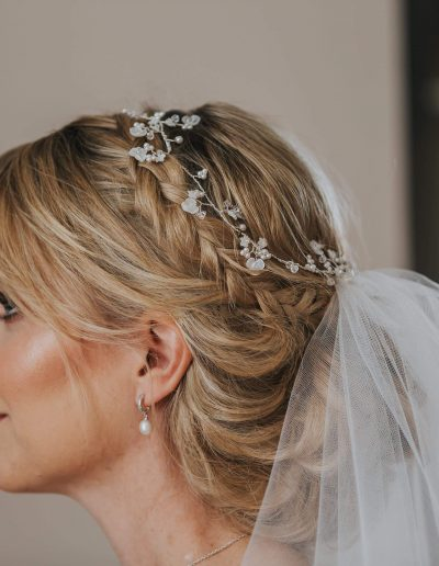 Kate chose our Petit Fleur bridal hair vine.  Delicate mother of pearl flowers, Swarovski crystal and pearls all intricately hardwired onto a flexible silver wire.  Image https://www.mattwing.co.uk/